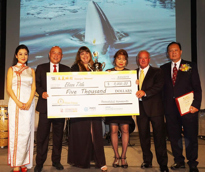 "SolarMax CEO David Hsu awards Elissa Title 1st place in the ""SolarMax Beautiful Moment"" Photography and Essay Contest"